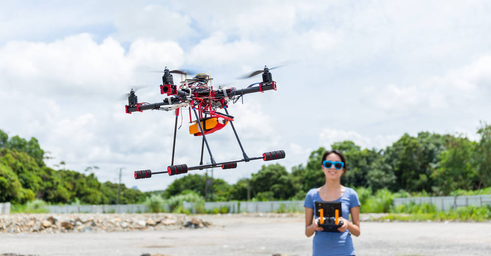 Young-Woman-fly-with-drone