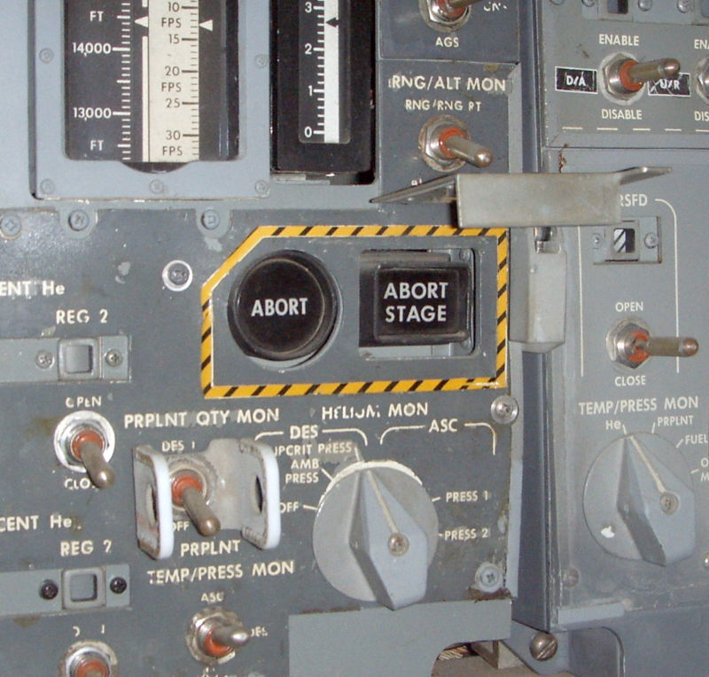 "The source of all the trouble: the Abort pushbutton (along with its companion the Abort Stage pushbutton). This particular image is of the LM simulator currently residing at the <a href=""https://www.cradleofaviation.org/"">Cradle of Aviation Museum</a> in Long Island."